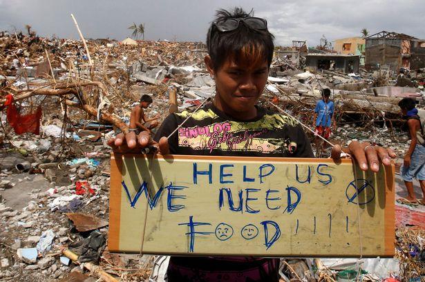 """Nạn nhân bão Hải Yến: """"Xin cứu giúp. Chúng tôi cần thực phẩm."""" Nguồn: Reuters"""