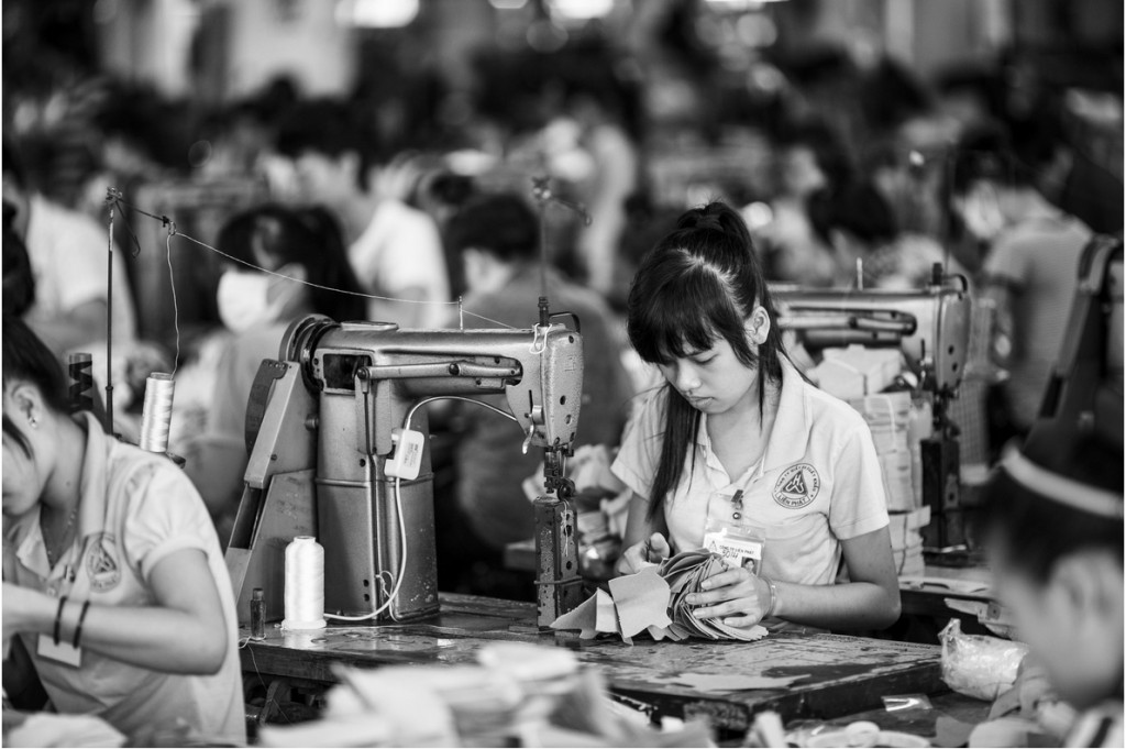 Photo: A factory making shoes (United Development) in Vietnam. US shoe import tax. Source: Aaron Joel Santos / The New York Times