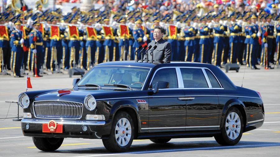 Chủ tịch Trung Quốc Tập Cận Bình duyệt binh cuộc diễn binh tại Bắc Kinh vào đầu tháng Chín, sẽ bắt đầu chuyến thăm Mỹ của ông ở Seattle. Nguồn: Ng Han Guan / Associated Press