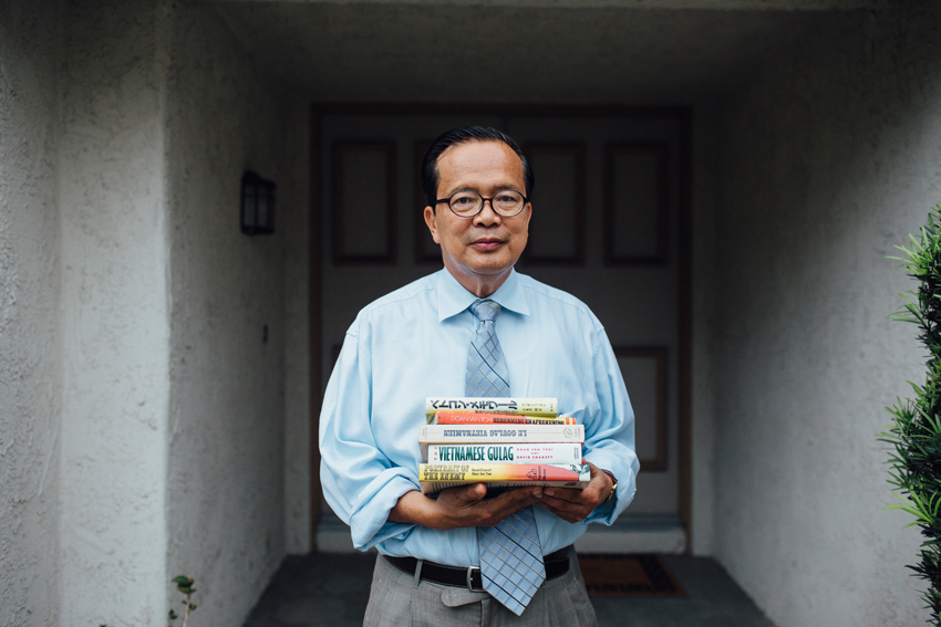 Ông Đoàn Văn Toại và tác phẩm của minh bên ngoài nhà của ông published books outside his home in Westminster, California October 27, 2015.